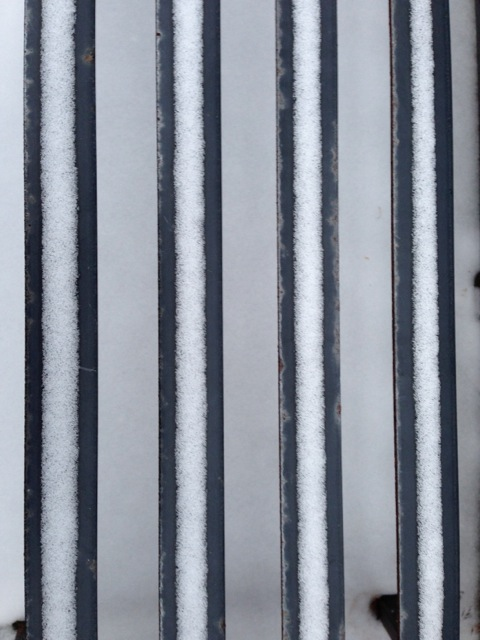 Snow covered bench slats