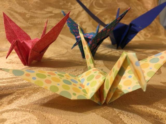 Four folded origami cranes